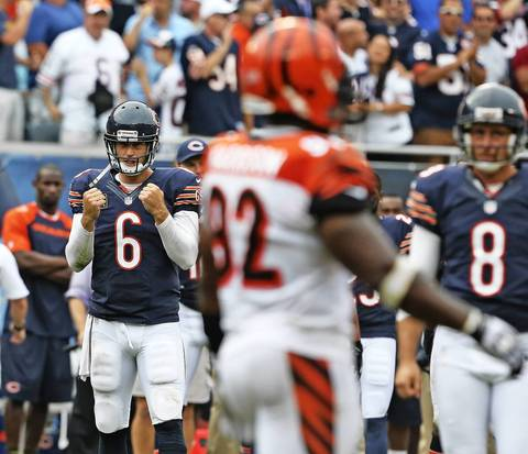 Jay Cutler pumps his fists after the touchdown by Brandon Marshall.