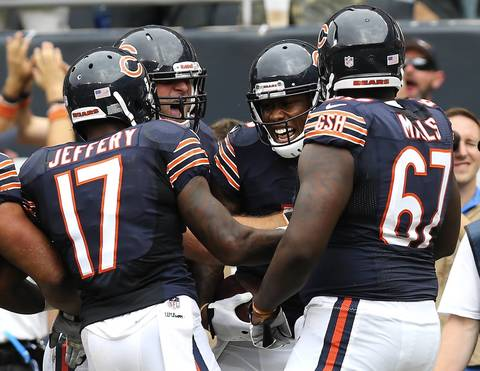 Brandon Marshall celebrates with teammates after his touchdown catch in the 4th quarter.