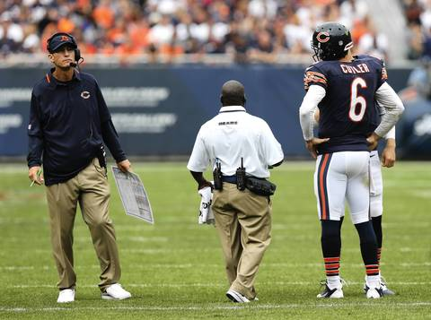 Bears coach Marc Trestman and quarterback Jay Cutler stand on the field during a timeout.