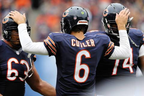 Jay Cutler celebrates with Roberto Garza and Jermon Bushrod after the Bears scored on a touchdown by Matt Forte in the third quarter.