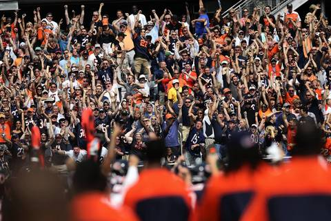 Bears fans react after a first quarter interception by cornerback Charles Tillman.