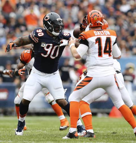 Julius Peppers rushes Bengals quarterback Andy Dalton.