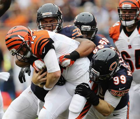 Defensive tackle Stephen Paea and defensive end Shea McClellin sack Bengals quarterback Andy Dalton in the 4th quarter.