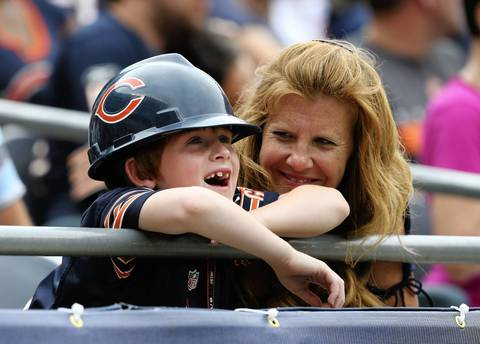 A young Bears fan smiles during the second half.