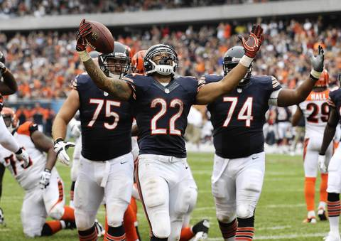 Matt Forte celebrates his touchdown against the Bengals during the third quarter.