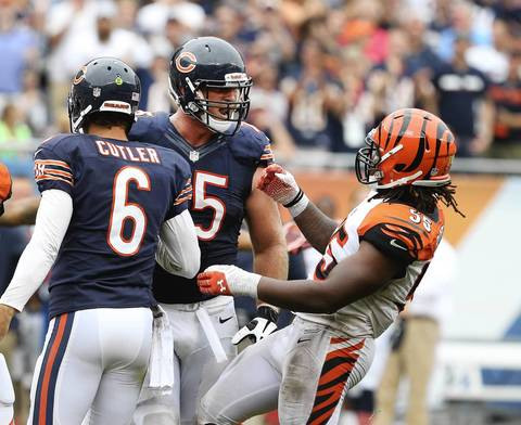 Offensive guard Kyle Long has words with Bengals outside linebacker Vontaze Burfict after a run by Jay Cutler for some yards during the fourth quarter.