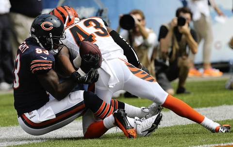 Chicago Bears tight end Martellus Bennett (83) makes a touchdown catch as Cincinnati Bengals free safety George Iloka (43) defends in the first quarter at Soldier Field.