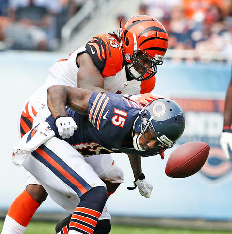 Chicago Bears wide receiver Brandon Marshall (15) , covered by Cincinnati Bengals outside linebacker Vontaze Burfict (55), fails to catch a pass during the first half of their game at Soldier Field, in Chicago, on Sunday.