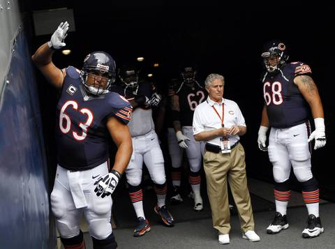 Roberto Garza bangs on the walls of the tunnel as the team takes the field.