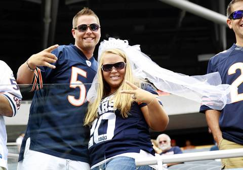 Becky and Doug Comer, of Elkhart, In., were married a week ago and spending part of their honeymoon at the Chicago Bears game at Soldier Field on Sept. 8.