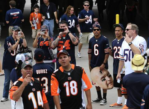 Fans make their way into Soldier Field on Sept. 8.