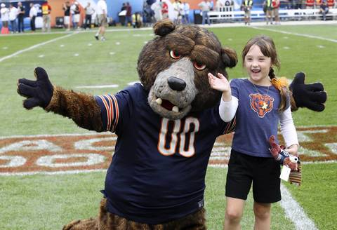 Staley with Ella Byrne, 6 before the start of the Chicago Bears season opener on Sept. 8.