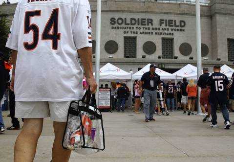 People walk to Soldier Field before the Chicago Bears season opener on Sept 8.