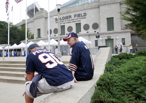 Daimon Ciavola, left, with his father Fred Ciavola, of Springfield Ma., wait outside Soldier Field, before the game between the Chicago Bears and the Cincinnati Bengals in Chicago on Sept. 8.