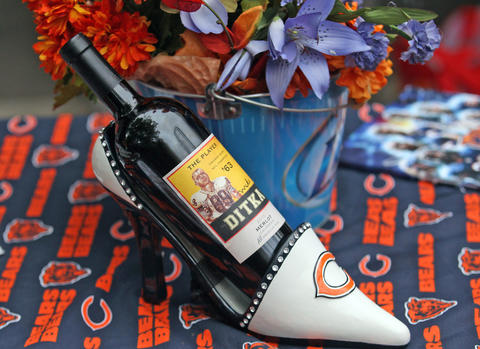 A bottle of wine lays inside of a decorated shoe during the tailgating in the Waldron Deck garage on Sept. 8.