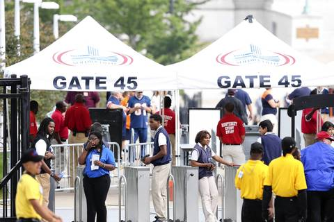 Security crews prepare for the arrival of fans on the north side of Soldier Field on Sept. 8.