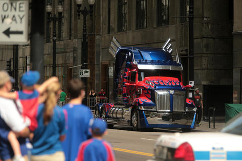 "Pedestrians stopped to look at the truck portraying Optimus Prime as it sat parked on LaSalle Street while a crew filmed scenes from the upcoming film ""Transformers 4"" in Chicago."