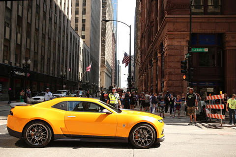 "The car portraying the character Bumblebee arrives on set as a crew filmed scenes from the upcoming film ""Transformers 4"" on LaSalle Street in Chicago."
