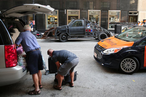 "Areas of downtown were blocked off as a crew filmed scenes from the upcoming film ""Transformers 4"" on LaSalle Street in Chicago."