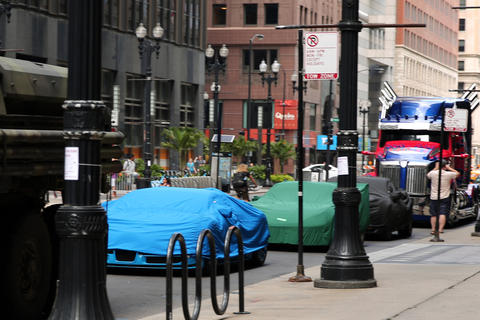 "Covered cars and the truck portraying Optimus Prime sit parked on LaSalle Street while a crew filmed scenes from the upcoming film ""Transformers 4"" in Chicago."