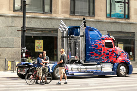 "Crew members stand nearby as the truck portraying Optimus Prime sits parked on LaSalle Street while a crew filmed scenes from the upcoming film ""Transformers 4"" in Chicago."