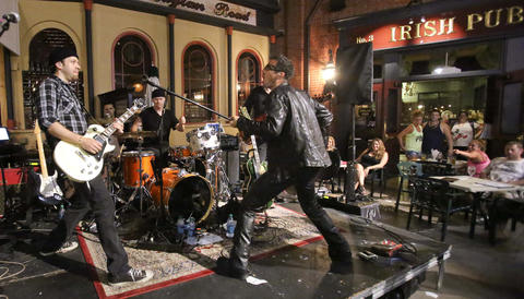 "The U2 tribute band 'Elevation,' from Toronto, Canada, performs at the 2nd Annual Great Irish Hooley, at Raglan Road Irish Pub at Downtown Disney, Sunday, September 1, 2013. From left, lead guitarist Kevin Strom (as The Edge); Shawn Brady (as Bono); drummer John ""Mullet"" Johnstone (as Larry Mullen, Jr.), and bass guitarist Mick Barnard (as Adam Clayton). They are scheduled to be back at Downtown Disney for a series of St. Patrick's Day concerts in March, 2014. Since 2002, Elevation has toured worldwide in 187 cities, including performances in Japan, Italy, Germany, Austria, Bosnia, Trinidad and the Dominican Republic.  It's their 11th year performing at Walt Disney World. (Joe Burbank/Orlando Sentinel) B583163982Z.1"