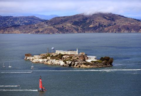 Emirates Team New Zealand passes in front of Alcatraz Island during race 5 of the America's Cup Finals against Oracle Team USA on September 10, 2013 in San Francisco, California.