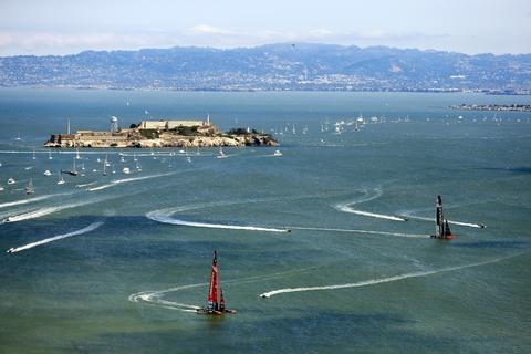 Oracle Team USA and Emirates Team New Zealand tack upwind in front of Alcatraz Island during race 5 of the America's Cup Finals on September 10, 2013 in San Francisco, California.