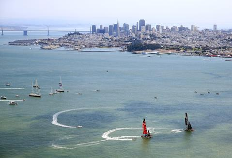 Emirates Team Zew Zealand and Oracle Team USA prepare for the start of race 5 of the America's Cup Finals in front of the San Francisco skyline on September 10, 2013 in San Francisco, California.
