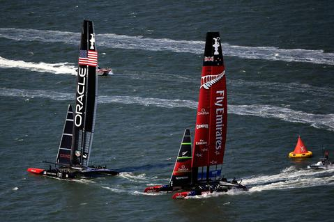 Oracle Team USA rounds the second mark ahead of Emirates Team New Zealand during race 5 of the America's Cup Finals on September 10, 2013 in San Francisco, California.