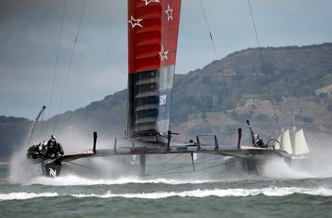 Emirates Team New Zealand skippered by Dean Barker in action against Oracle Team USA skippered by James Spithill during race five of the America's Cup Finals on September 10, 2013 in San Francisco, California. Emirates Team New Zealand won the race.