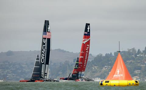 Oracle Team USA skippered by James Spithill in action against Emirates Team New Zealand skippered by Dean Barker during race five of the America's Cup Finals on September 10, 2013 in San Francisco, California.  Emirates Team New Zealand won the race.