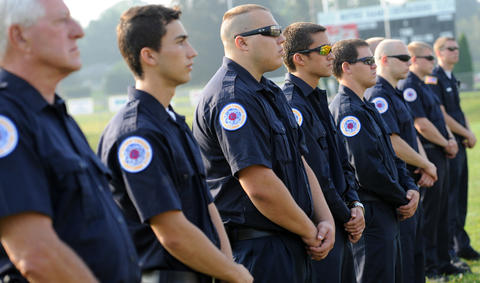Firefighters from Bethlehem Twp. Stations 14 and 17 stand by during ceremony.  Notre Dame High School in Bethlehem Twp. remembered terrorist attacks of Sept. 11, 2001 with a memorial prayer service before the start of classes.