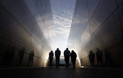 People walk through the 9-11 Empty Sky memorial across from New York's One World Trade Center at Liberty State Park in Jersey City, New Jersey, September 9, 2013. New York will mark the 12th anniversary of the 9-11 attack on the World Trade Center on Wednesday.