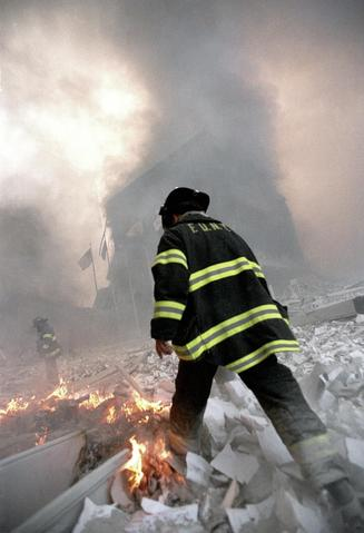 "Image of firefighter at Ground Zero at the World Trade Center, NYC, on Sep. 11,2001. The image appears in a documentary ""The Day the Towers Fell"" by Easton producer Lou Reda."