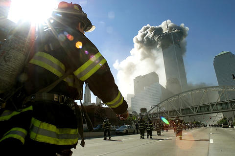 Firefighters walk towards one of the towers at the World Trade Center before it collapsed after a plane hit the building September 11, 2001 in New York City. This September 11 marks ten years since members of Al Qaeda hijacked four planes, attacking the World Trade Center and the Pentagon and crashing one in Shanksville, Pennsylvania, killing nearly 3,000 people in all. The effects continue to resonate across the global political landscape, as the United States concluded a nearly decade-long search for Al Qaeda leader Osama bin Laden, killing him in May 2011, and struggles to wind down two wars in Afghanistan and Iraq.  (Photo by Jose Jimenez/Primera Hora/Getty Images) ORG XMIT: ** TCN OUT **  ***** Series:  9/11 TEN YEARS LATER *** Headline:  How did the events  of 9/11 shape your life? ** The Morning Call asked readers to offer their personal reflections about the 10th anniversary of 9/11.
