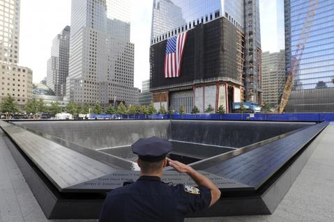 NEW YORK, NY - SEPTEMBER 11: New York City Police Officer Danny Shea, a military vet, salutes at the North pool of the 9/11 Memorial during the tenth anniversary ceremonies of the September 11, 2001 terrorist attacks at the World Trade Center site, September 11, 2011 in New York City. New York City and the nation are commemorating the tenth anniversary of the terrorist attacks on lower Manhattan which resulted in the deaths of 2,753 people after two hijacked planes crashed into the World Trade Center.
