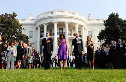 US President Barack Obama, First Lady Michelle Obama, Vice President Joe Biden and Jill Biden observe a moment of silence to mark the 12th anniversary of the 9/11 attacks on the South Lawn of the White House in Washington, DC, on September 11, 2013.