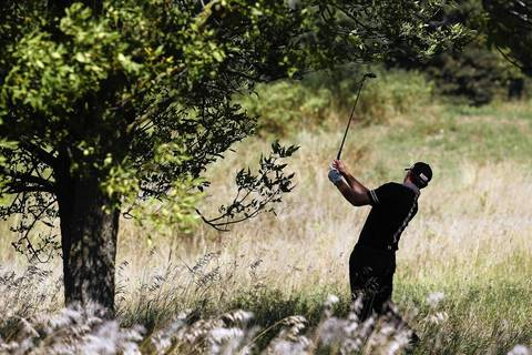Jimmy Walker chips out of the grassy area on the 9th fairway on the first round of the BMW Championship at Conway Farms Golf Club in Lake Forest on Thursday.