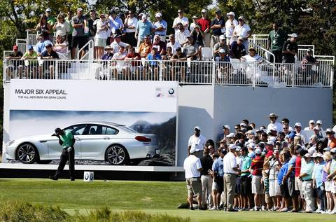 Tiger Woods reacts to a shot from the 11th tee on the first round of the BMW Championship at Conway Farms Golf Club in Lake Forest on Thursday.