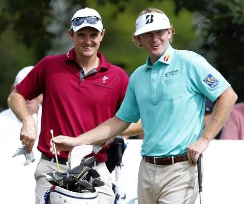 Justin Rose, left, and Brandt Snedeker chat before teeing off on the 10th of the first round of the BMW Championship at Conway Farms Golf Club in Lake Forest on Thursday.