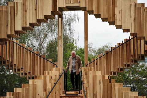 A man walks on an installation entitled 'Endless Stair' designed by de Rijke Marsh Morgan Architects (dRMM) near the Tate Modern gallery in central London on September 13, 2013. Inspired by MC Escher's famous surreal drawings of never-ending staircases, it was created to mark the launch of the London Design Festival which runs from 14th - 22nd September.