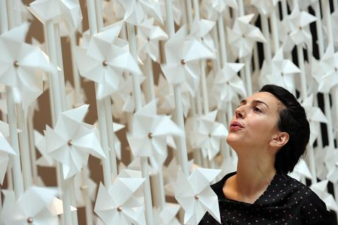 ADDING RESTRICTIONS Lebanese designer, Najla el-Zein, poses blowing fans on her installation entitled 'Wind Portal' at the Victoria and Albert Museum in central on September 13, 2013. The work forms part of the London Design Festival at the Victoria and Albert exhibition.