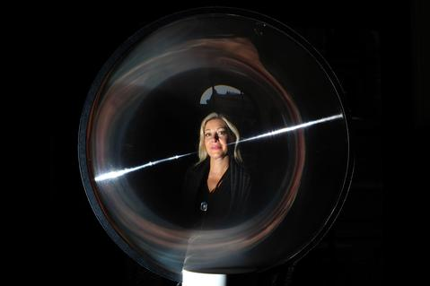 Nadja Swarovski, the great-great-granddaughter of Swarovski founder Daniel Swarovski, poses for a photograph through a Swarovski lens installation entitled 'God is in the Details' at the Victoria and Albert Museum in central on September 13, 2013. The work forms part of the London Design Festival at the Victoria and Albert exhibition.