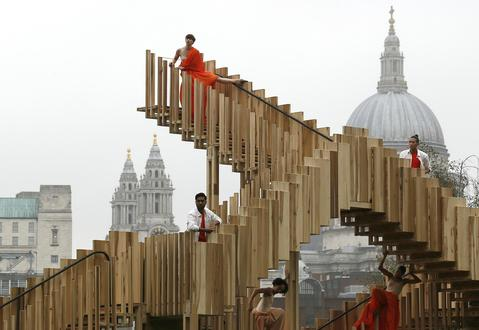 "Dancers perform on the installation ""Endless Stair"" designed by dRMM architects during the London Design Festival outside Tate Modern in London September 13, 2013."