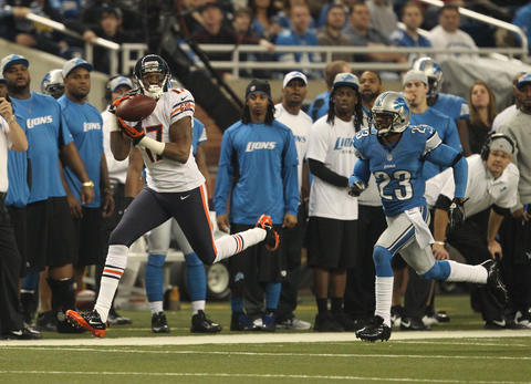 Wide receiver Alshon Jeffery hauls in a long pass from Jay Cutler while being chased by Lions cornerback Chris Houston during the first quarter.