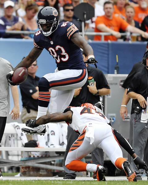 Martellus Bennett tries to leap over Bengals free safety George Iloka in the third quarter.