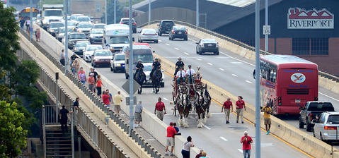 The Budweiser Clydesdales makes their way across the New Street Bridge Thursday afternoon.