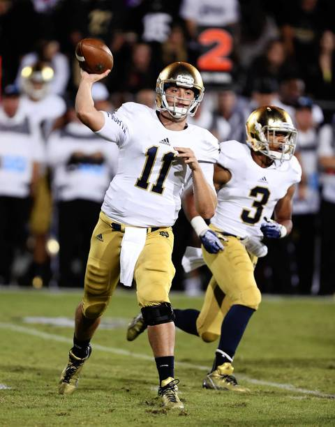 Notre Dame quarterback Tommy Rees throws a pass.