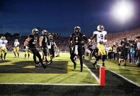 Purdue's Akeem Hunt reacts to scoring a touchdown against Notre Dame.